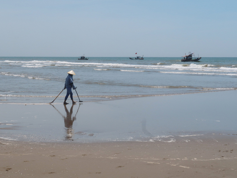 Treasure hunter on Sam Son Beach
