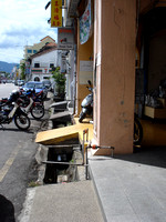 Open gutter and bike ramps along a five foot way, Georgetown, Penang - Malaysia.