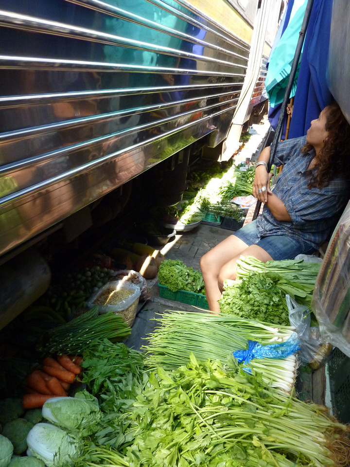 Train passing over food - Maeklong Thailand