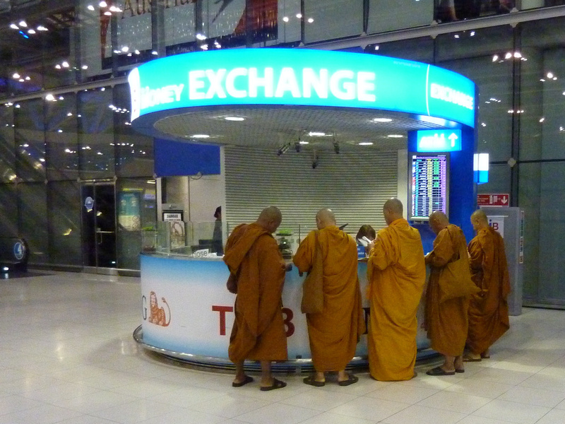 Monks at a currency exchange