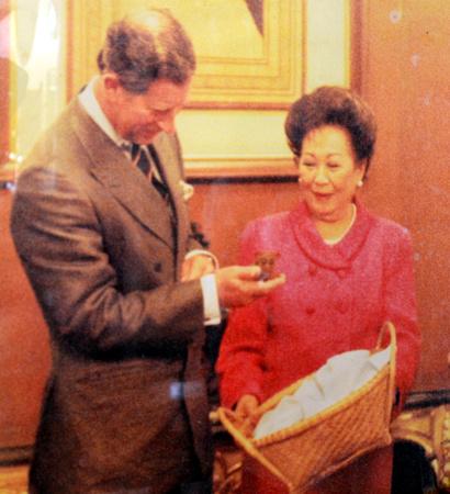 Prince Charles holding a tarsier