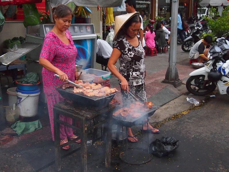 Pyjama ladies grilling pork