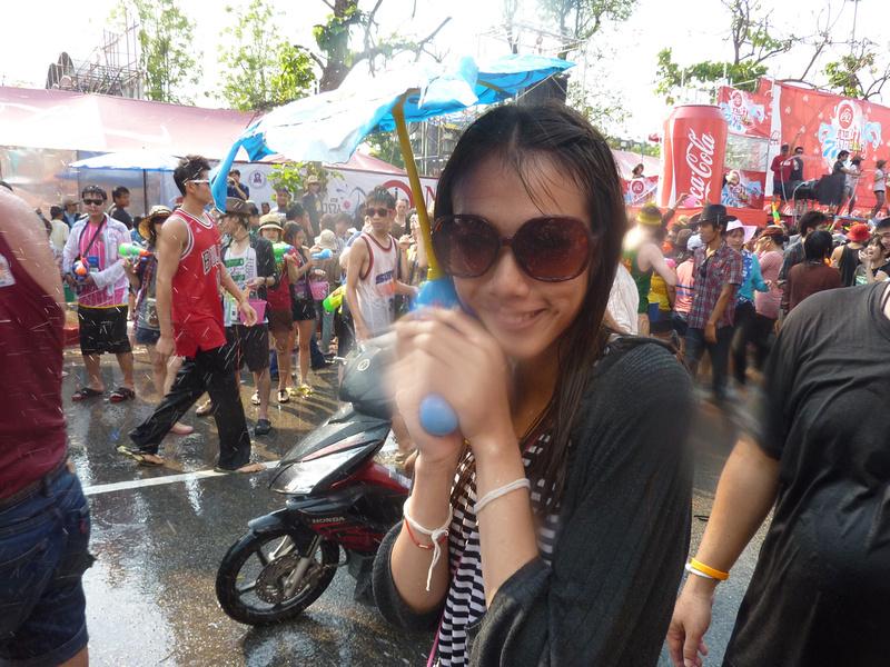 Songkran Chiang Mai - Girl with umbrella gun