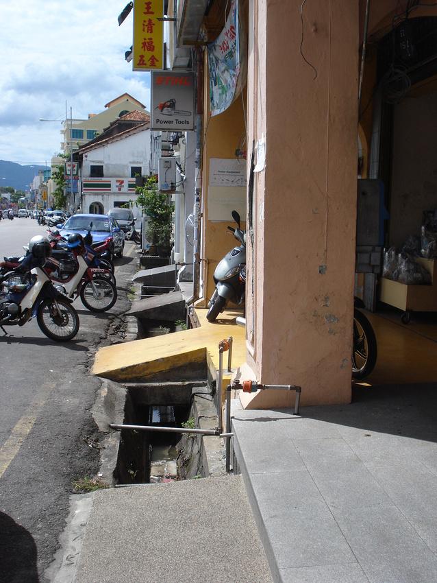 Open gutter and bike ramps along a five foot way, Georgetown, Penang - Malaysia.