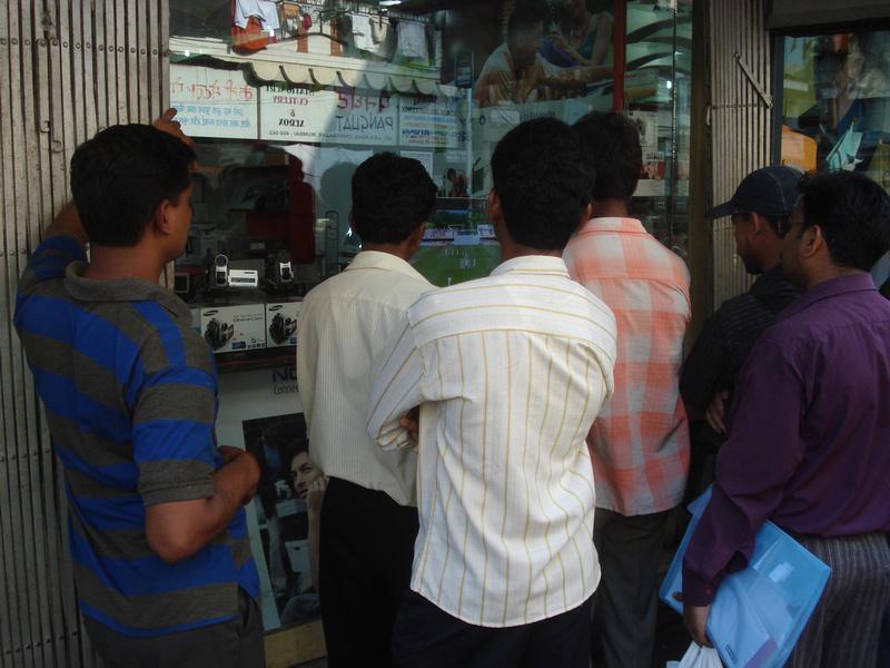 Men watching cricket