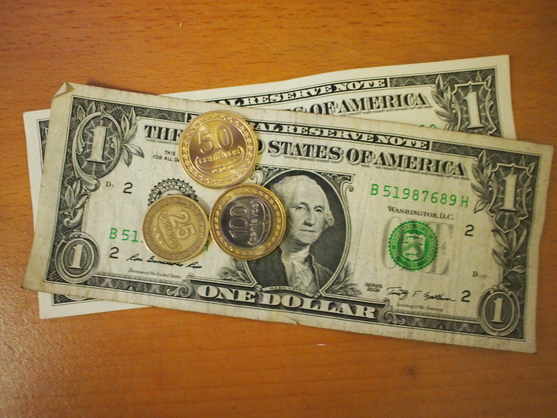 US Dollars and East Timor centavo coins