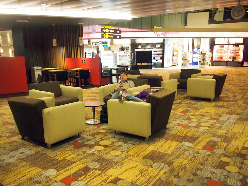 Sleeping on chairs - Singapore Changi Airport