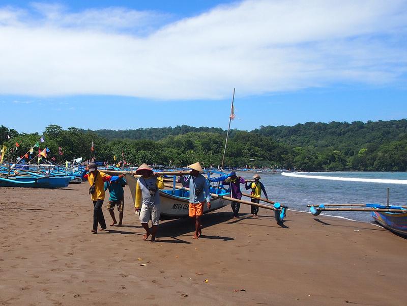 Fishermen beaching a boat